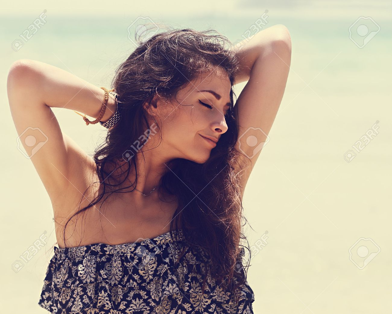 vintage armpits Happy beautiful closed eyes woman relaxing with epilation armpits on blue  sea background. Closeup vintage