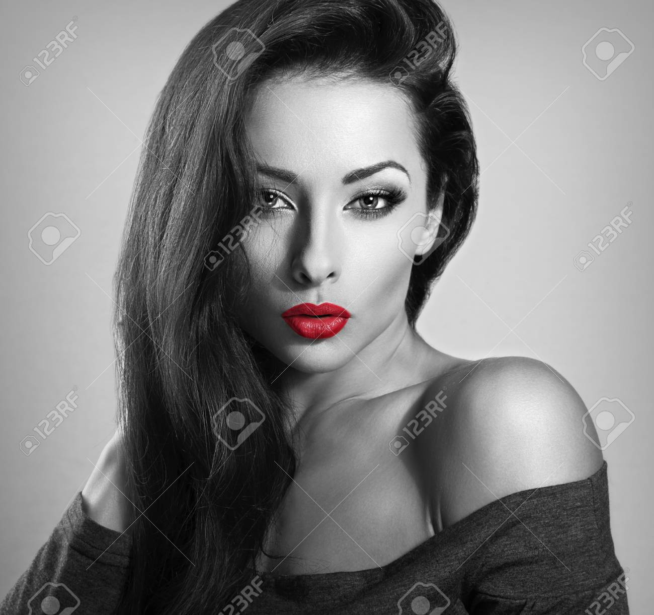 Beautiful brunette make up sexy woman with red lipstick looking