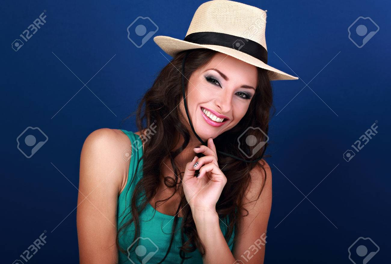 Natural expression smiling beautiful woman in straw summer hat with long  curly hair style looking on 6651bcf2142
