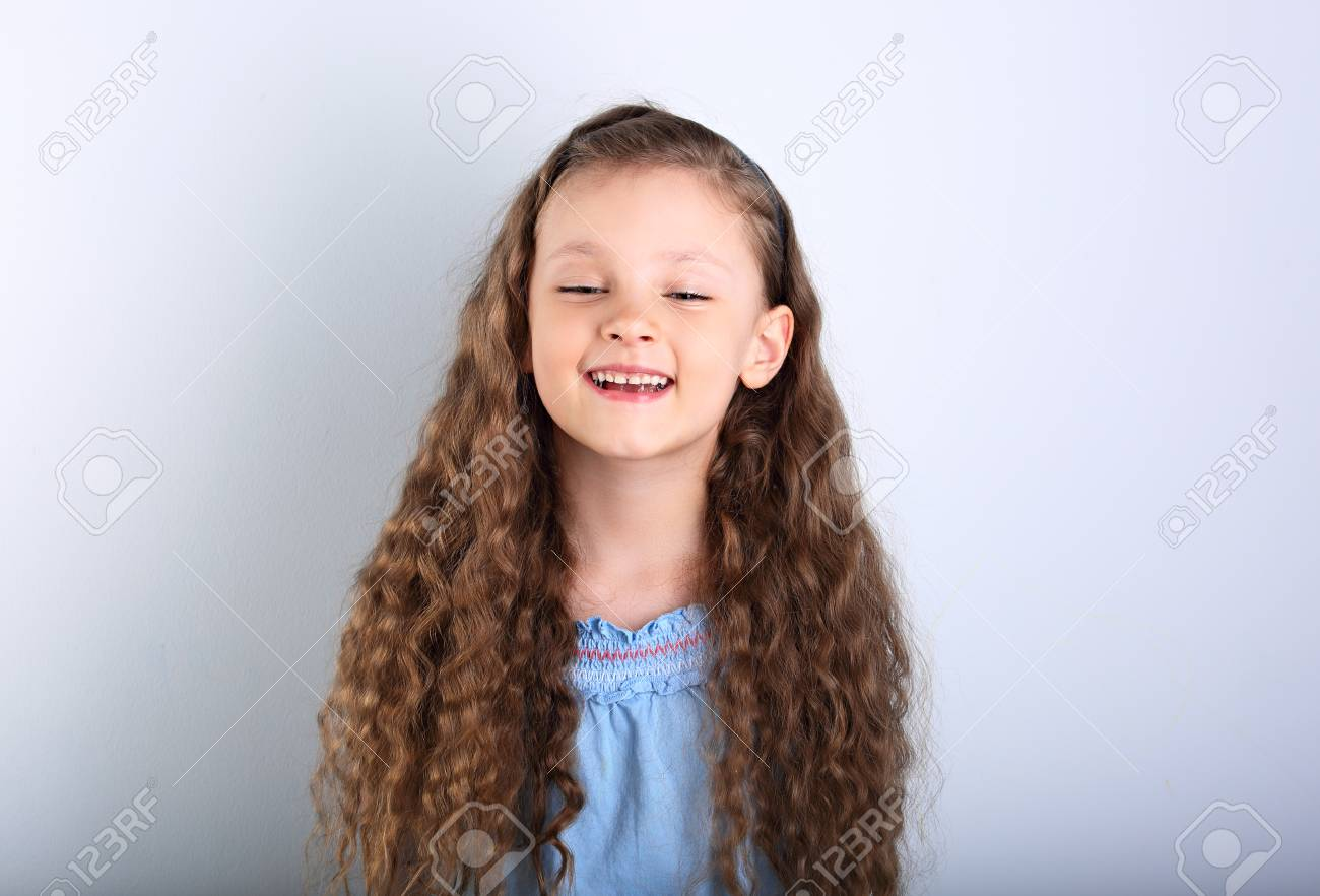 Beautiful Natural Expression Laughing Kid Girl Looking With Long Stock Photo Picture And Royalty Free Image Image 82868038