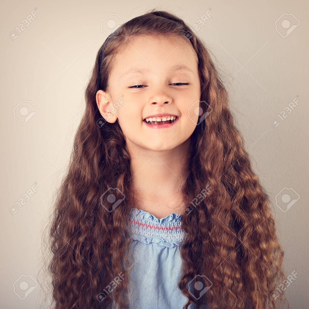Beautiful Natural Expression Laughing Kid Girl Looking With Long Stock Photo Picture And Royalty Free Image Image 82868102