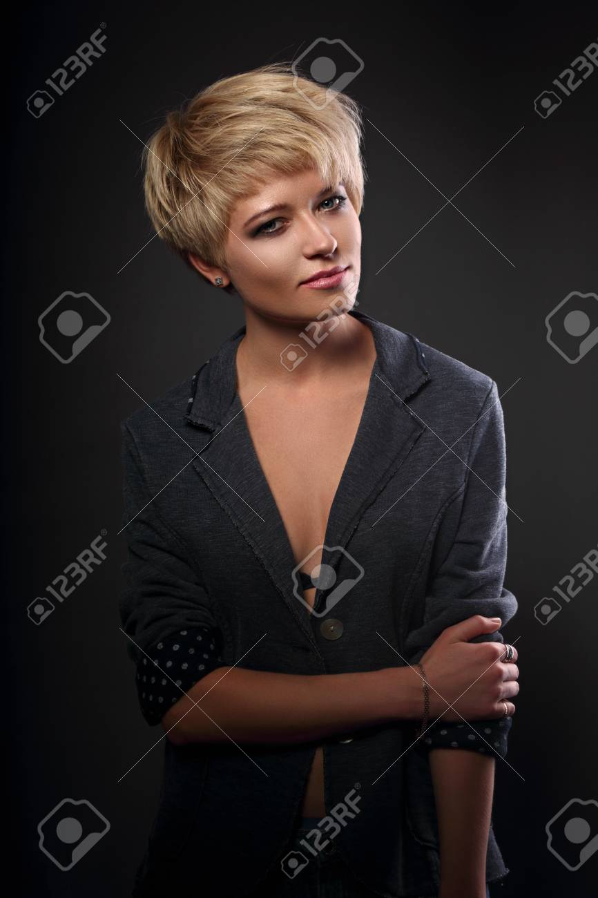 Beautiful Serious Sexy Woman With Short Bob Blond Hairstyle In