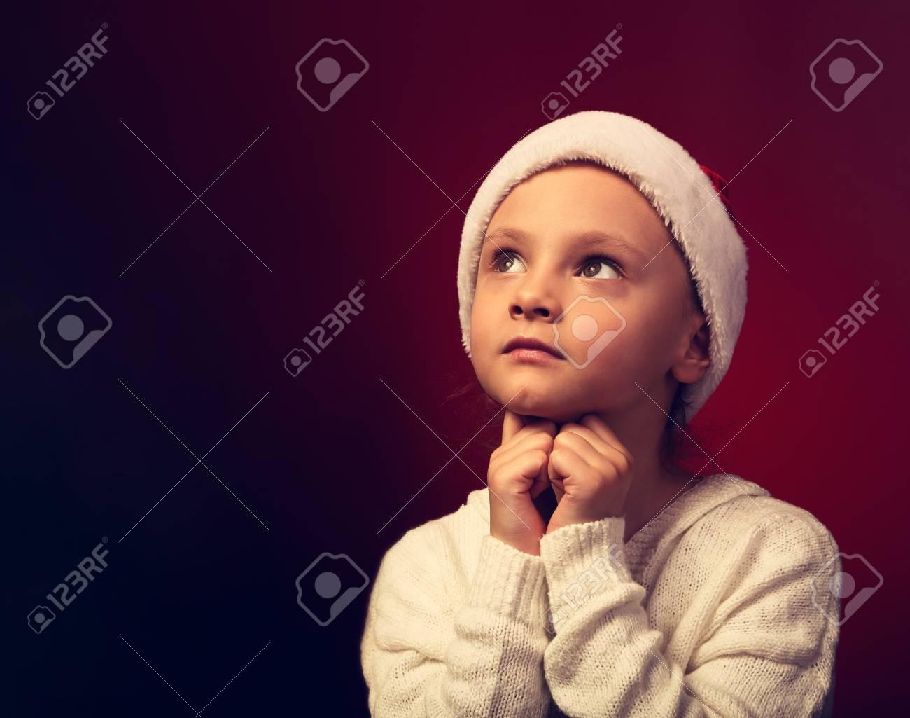 6d15feb985ae5 Cute Happy Kid Girl In Fur Christmas Santa Claus Hat Asking
