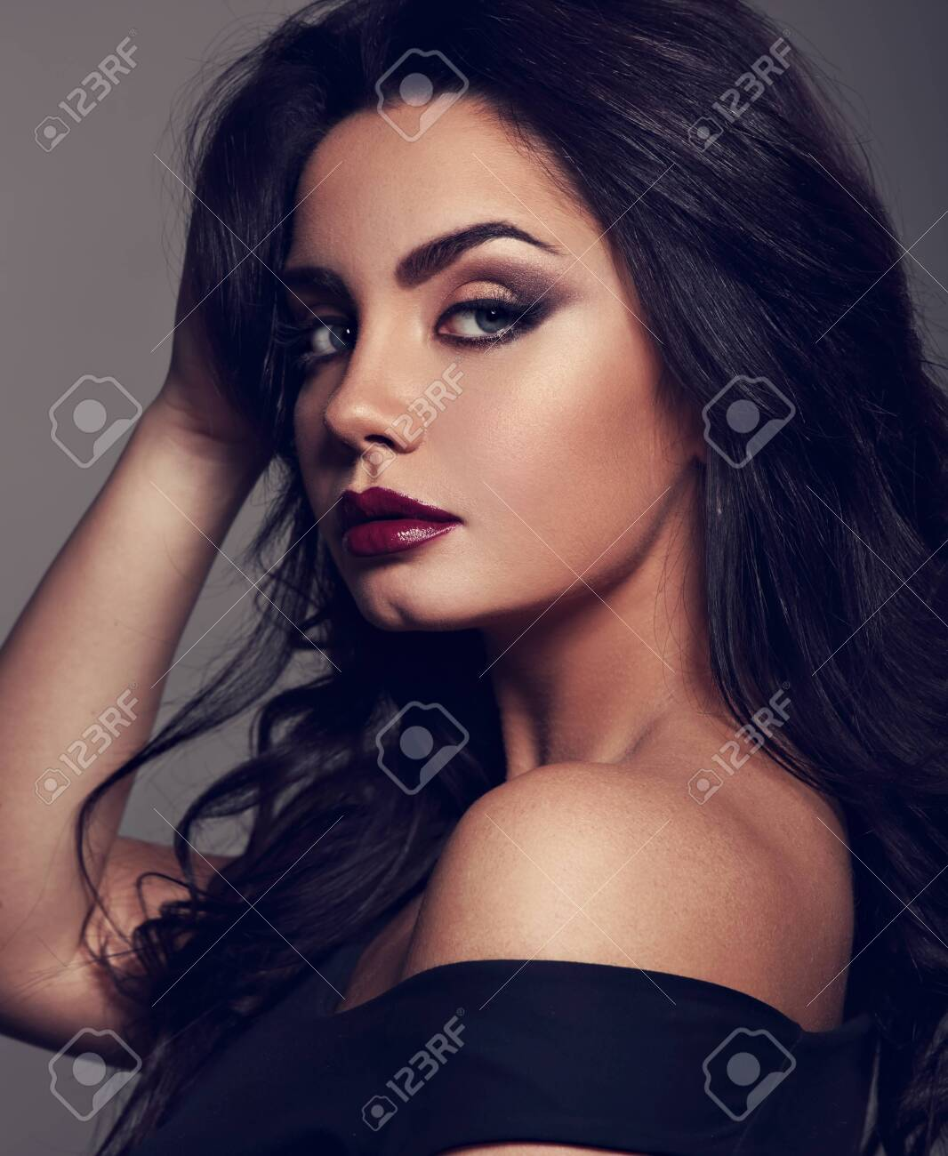 Beautiful Bright Makeup Woman With Long Black Curly Hair Style