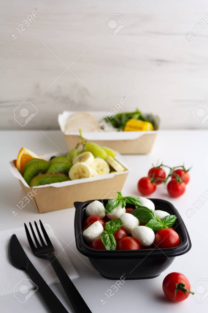 Different types of takeaway food on a light background - 158705706