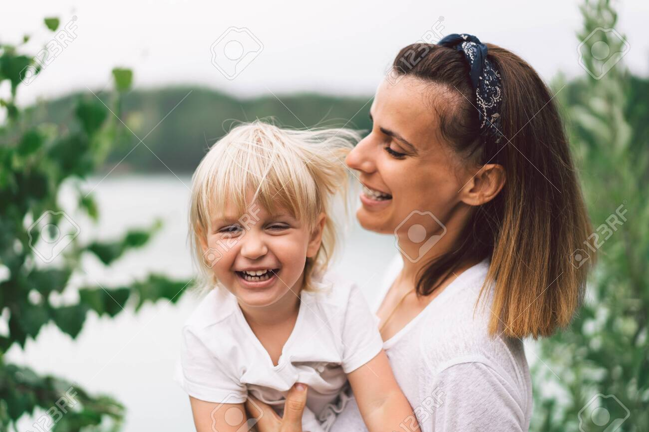 Young mother holding her baby. Mother and little daughter having good time in the nature. Mothers Day. Family Concept - 154209117