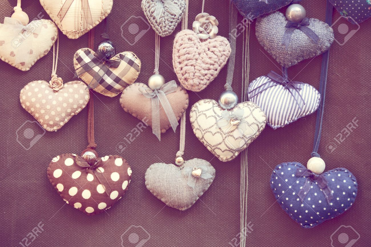 Toned photo of group of handmade hearts in romantic shabby chic style Stock Photo - 14389595