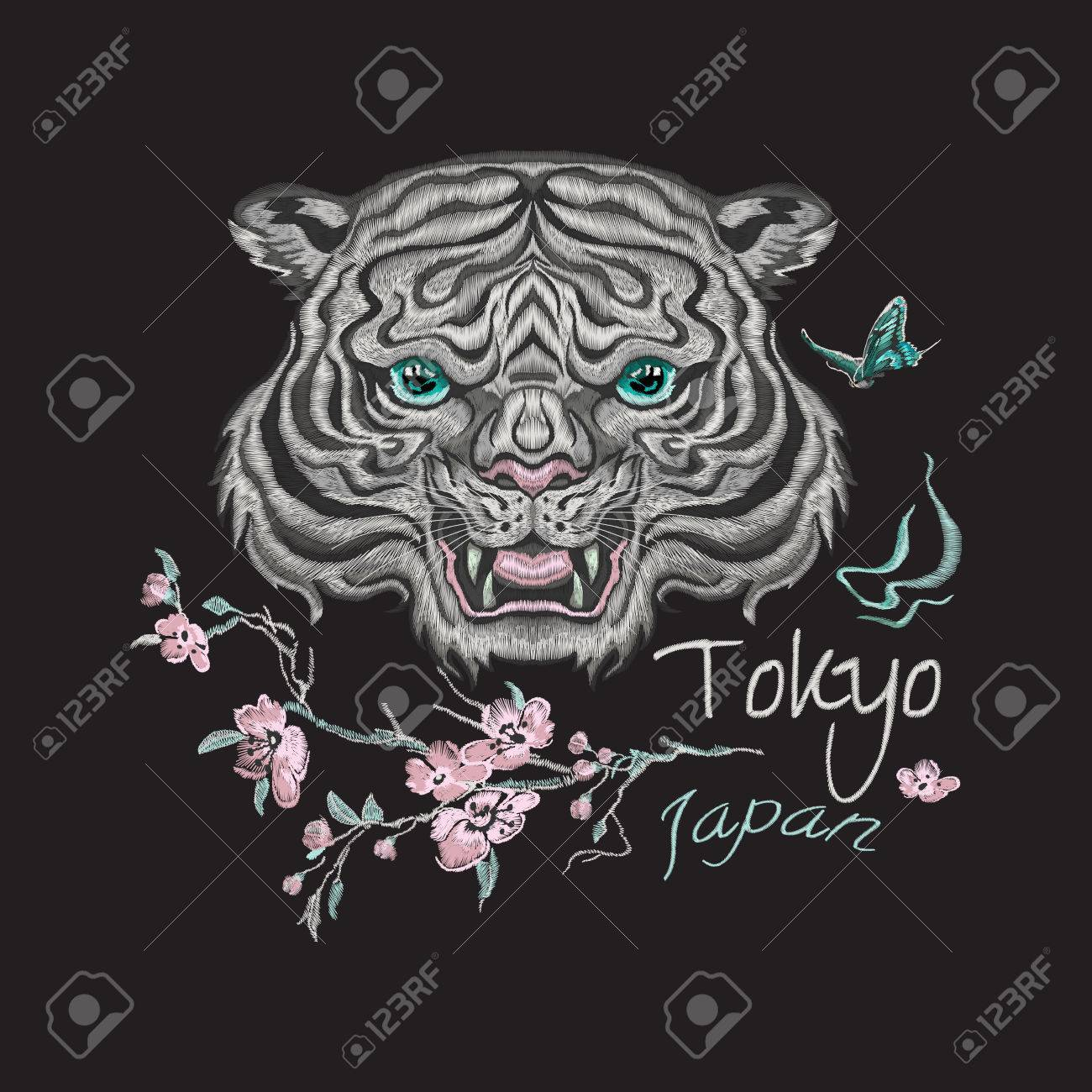 612430879 Embroidery floral patch with tiger head, flowers and butterflies. Vector  embroidered oriental sticker for