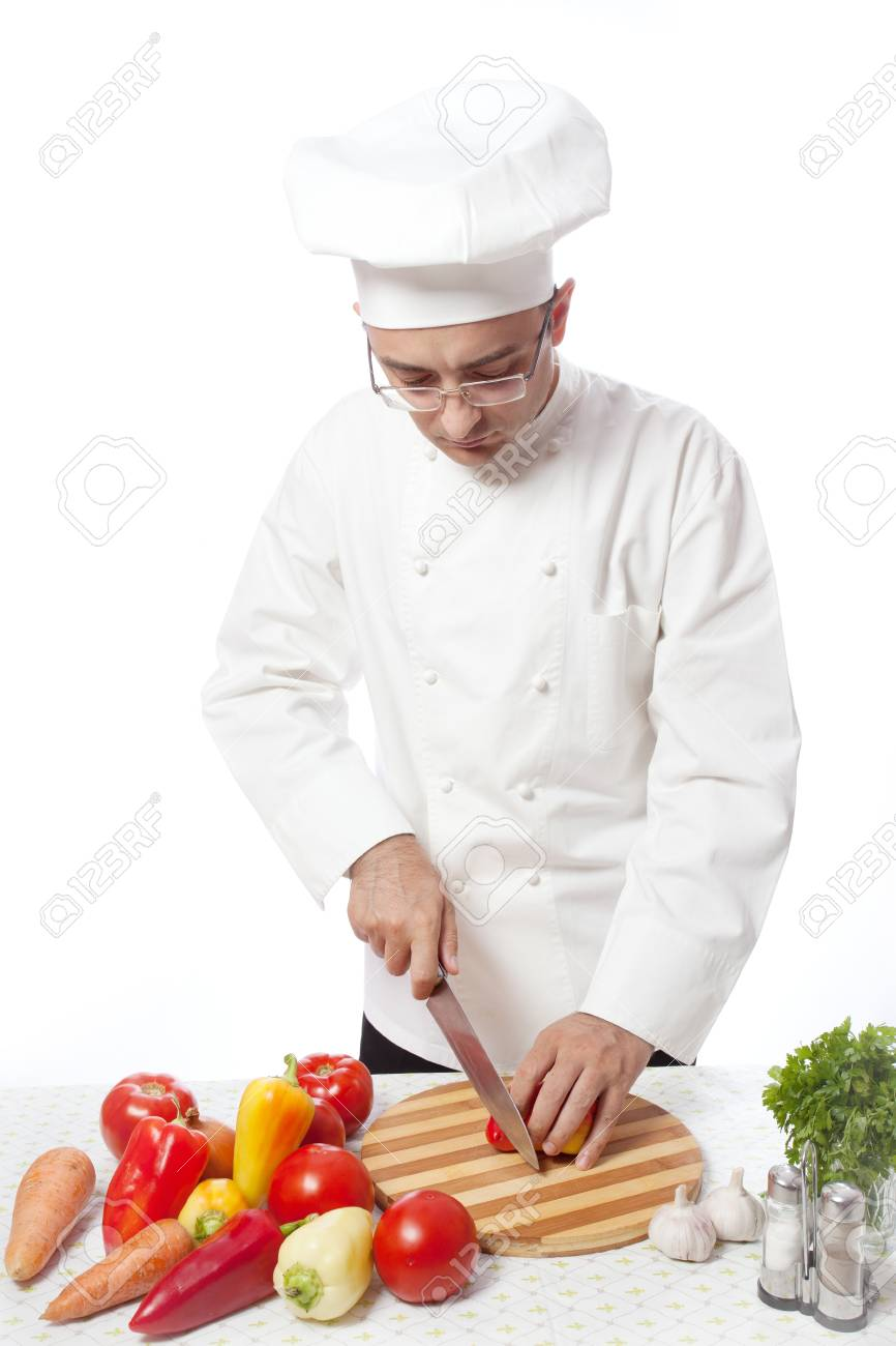 Man in white cooking fruits and vegetables Stock Photo - 12511915