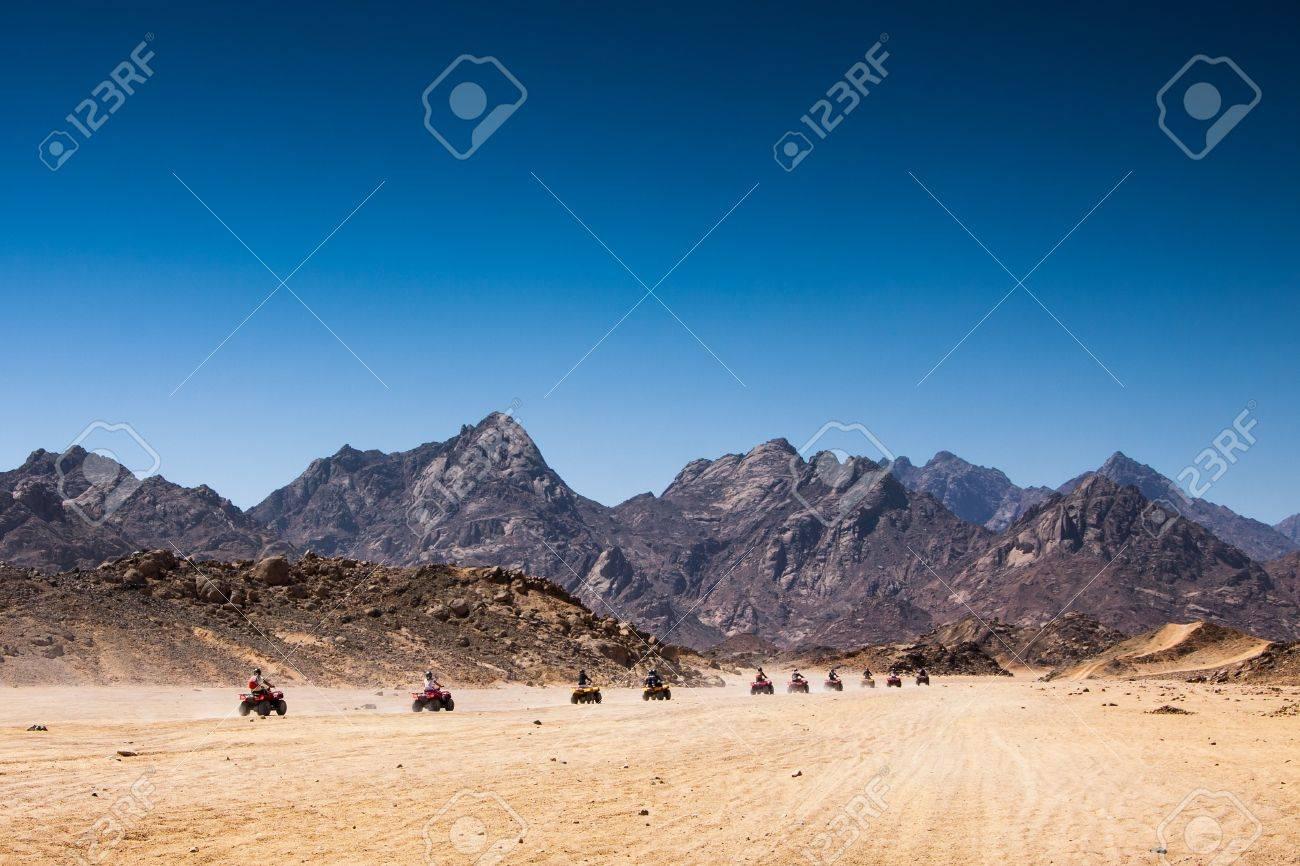 Safari Tours by quad bike in Egypt Tourists riding quadbikes in desert - 20649940