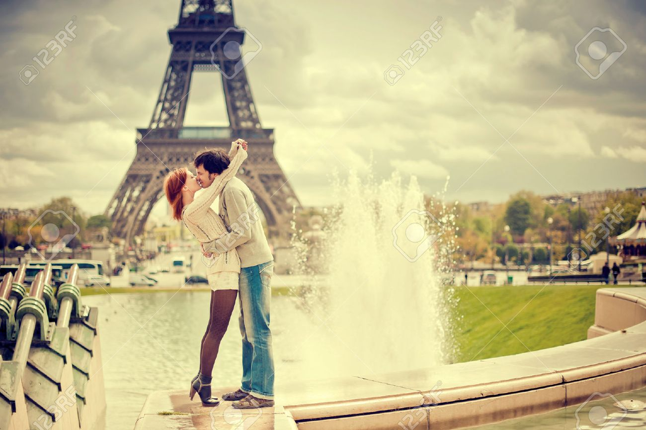 Lovers kissing in Paris with the Eiffel Tower in the Background - 36076221