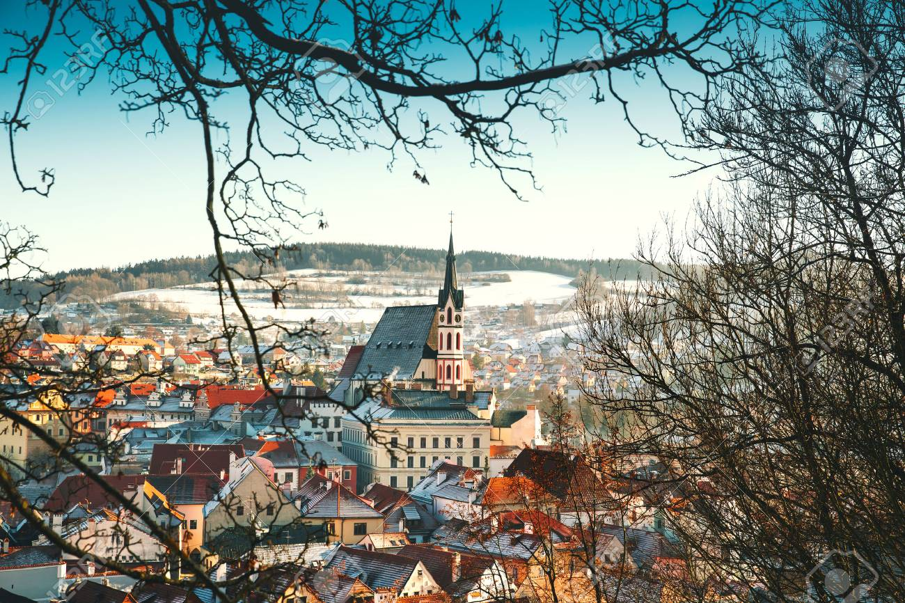 Panoramic view of Cesky Krumlov in winter, Czech Republic. View of the snow-covered red roofs. Travel and Holiday in Europe. Christmas and New Year time. Sunny winter day in european town. - 88125498