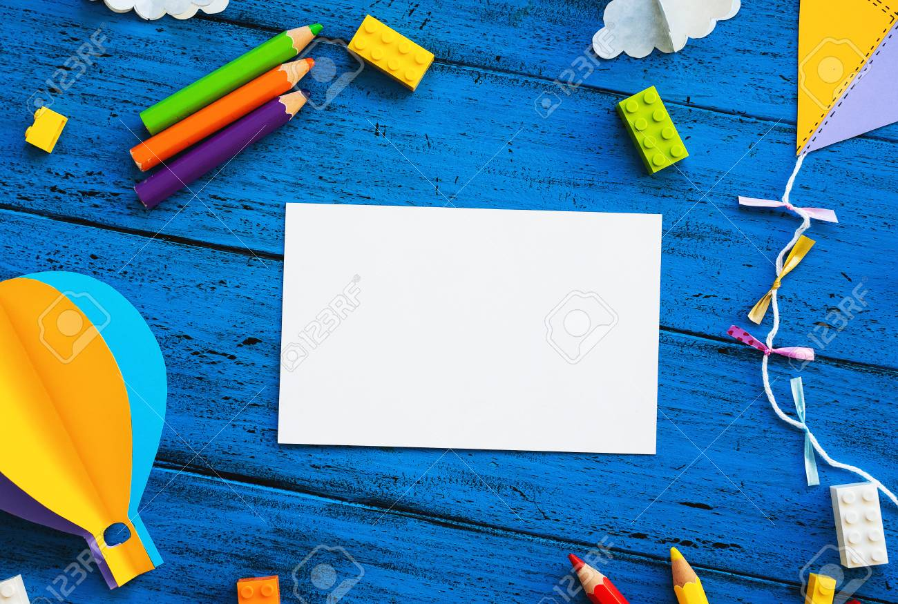 D Olourful Toy Bricks Paper Crafts And Blank Card On Blue Wood Board School Or Preschool Creative Background Concept Of Diy Construction