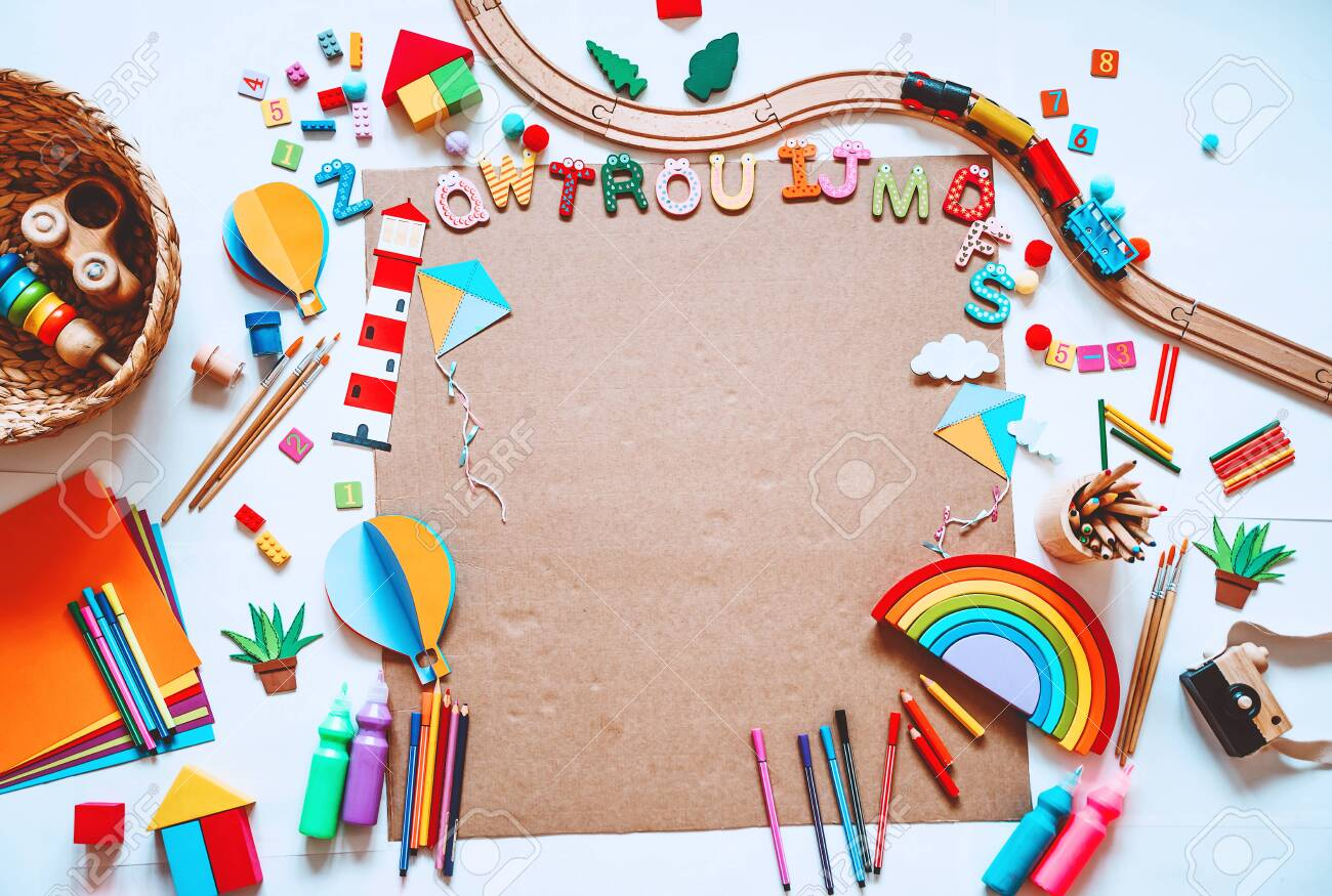 Background for preschool or kindergarten or art classes. Kids educational toys and school supplies for draw and make DIY crafts. Flat lay top view. Art child frame with empty paper, mock up for text - 131199107