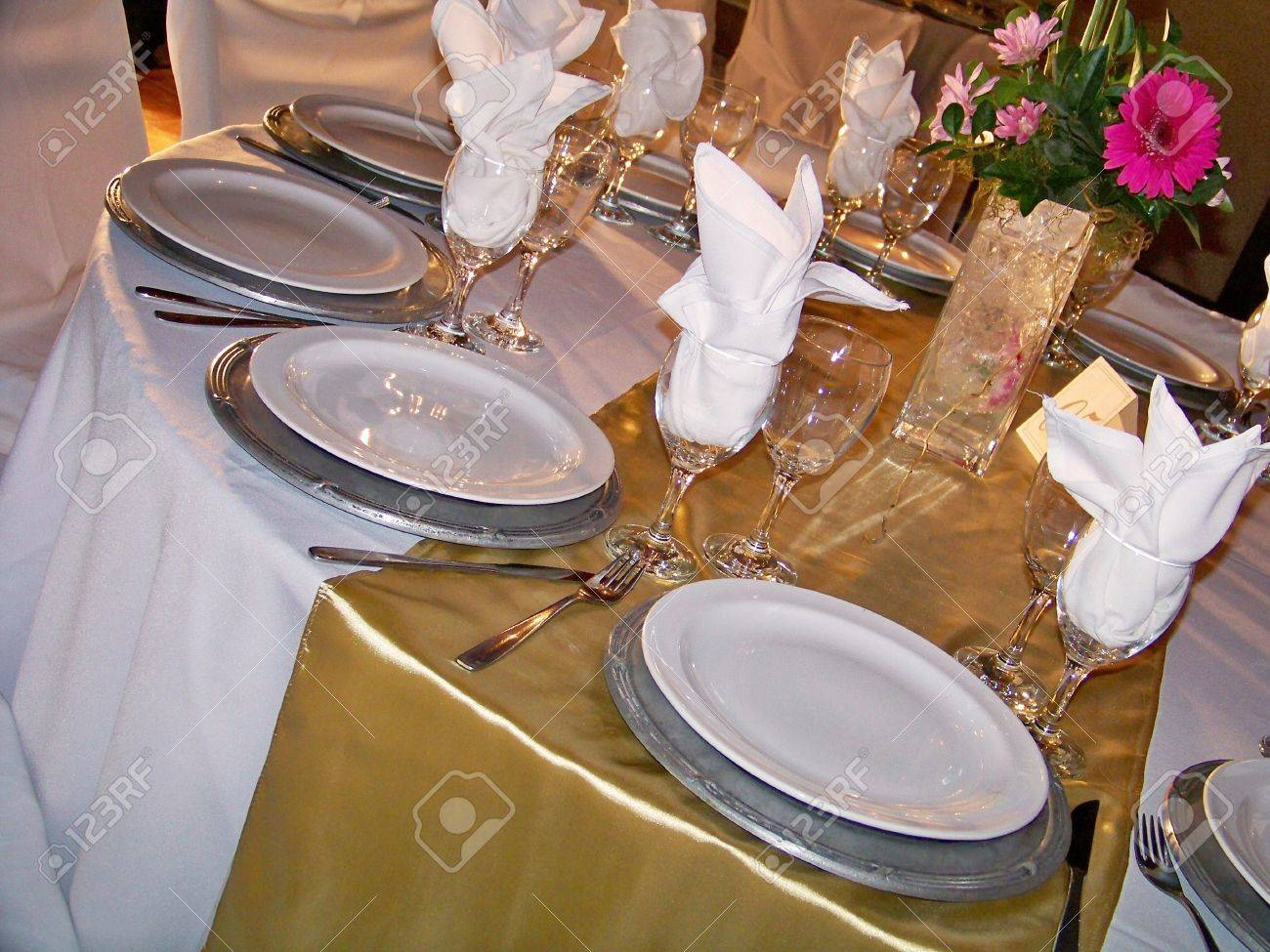 elegant sophisticated wedding table in brilliant gold silver and white stock photo 12622504