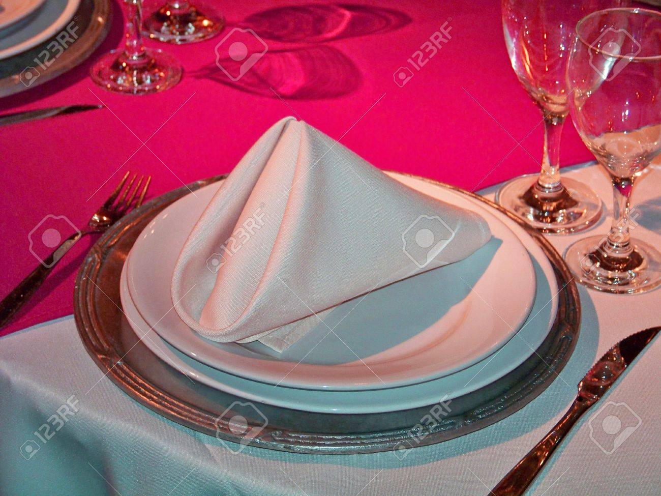 An elegant place in a restaurant table in silver, white and intense magenta pink in metal, ceramic and glass Stock Photo - 12623611