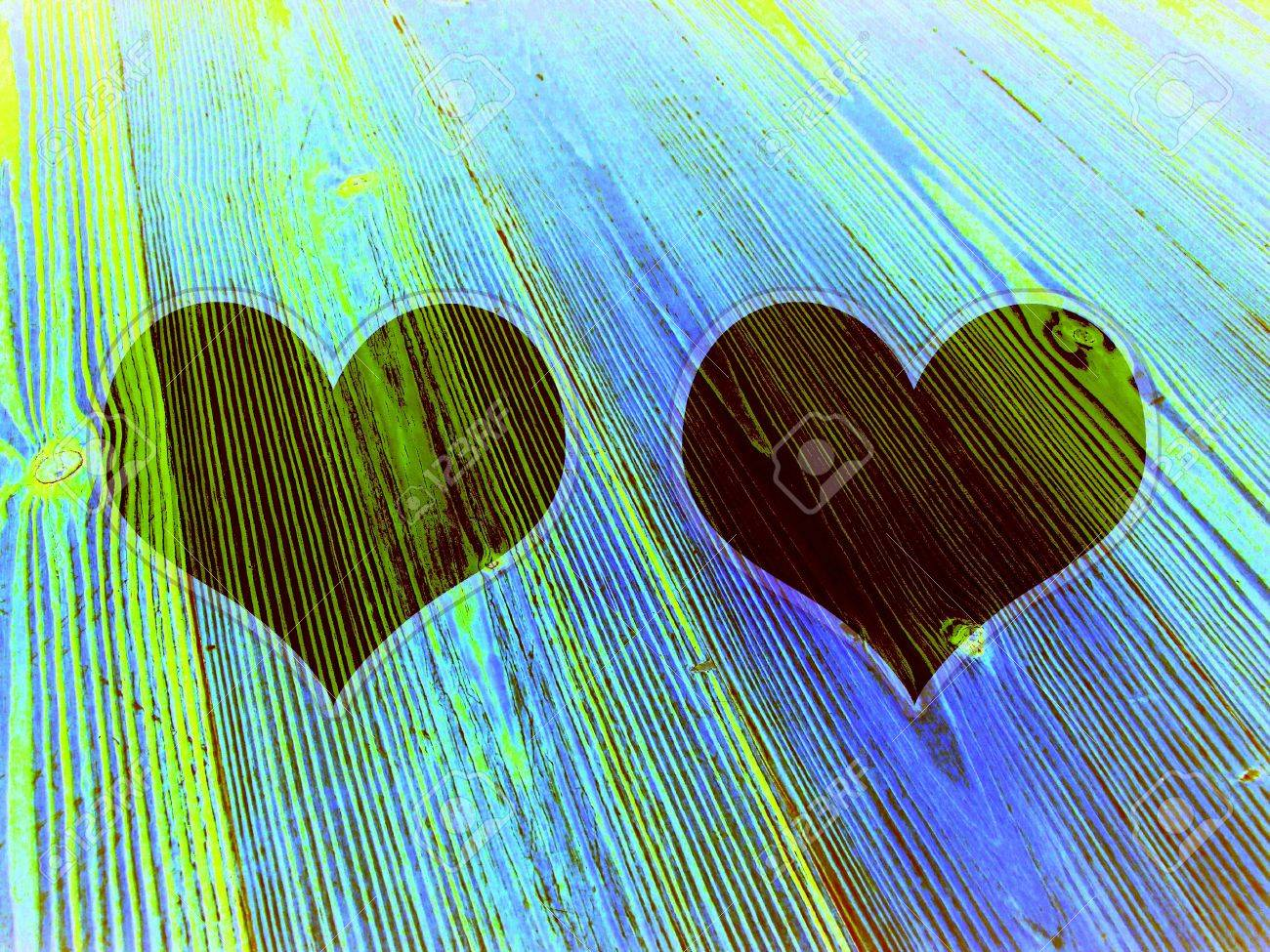 Two dark hearts on old wood in green and blue Stock Photo - 13114215
