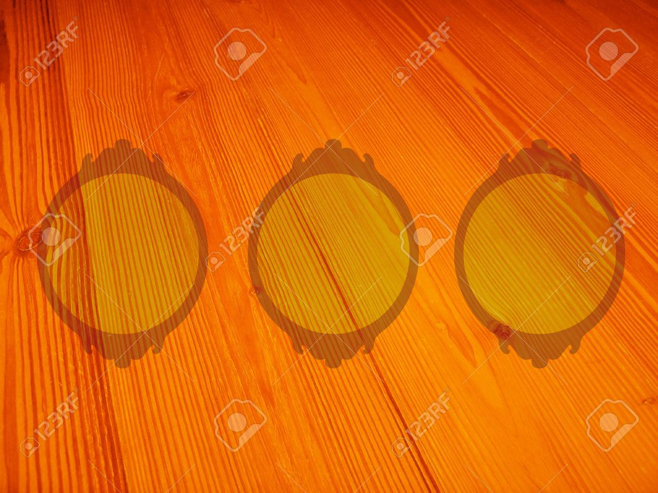 Orange old wood background with three empty circular frames for pictures Stock Photo - 13202353