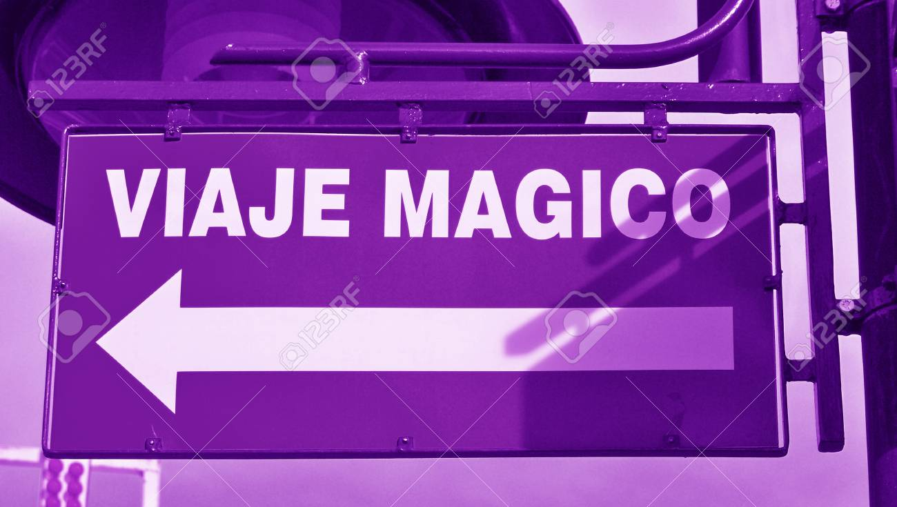 violet urban signal with magic trip words in spanish stock photo
