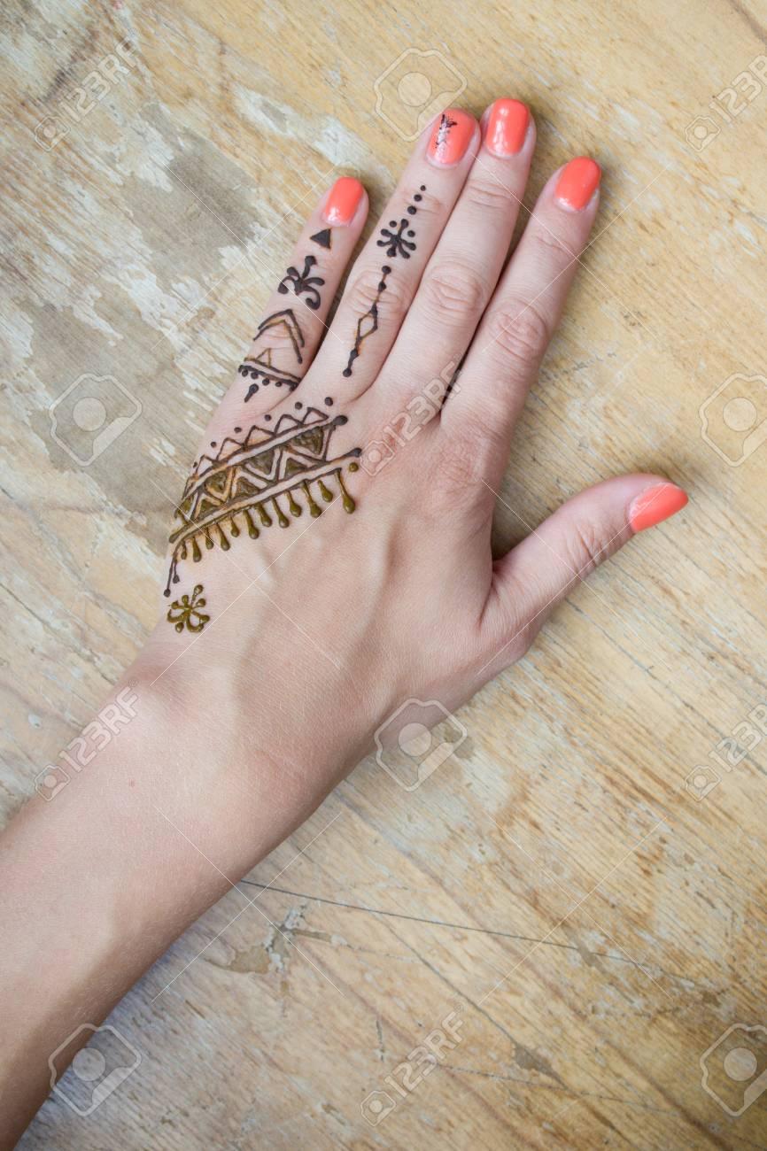 beauty concept , Artist applying henna tattoo on women hands