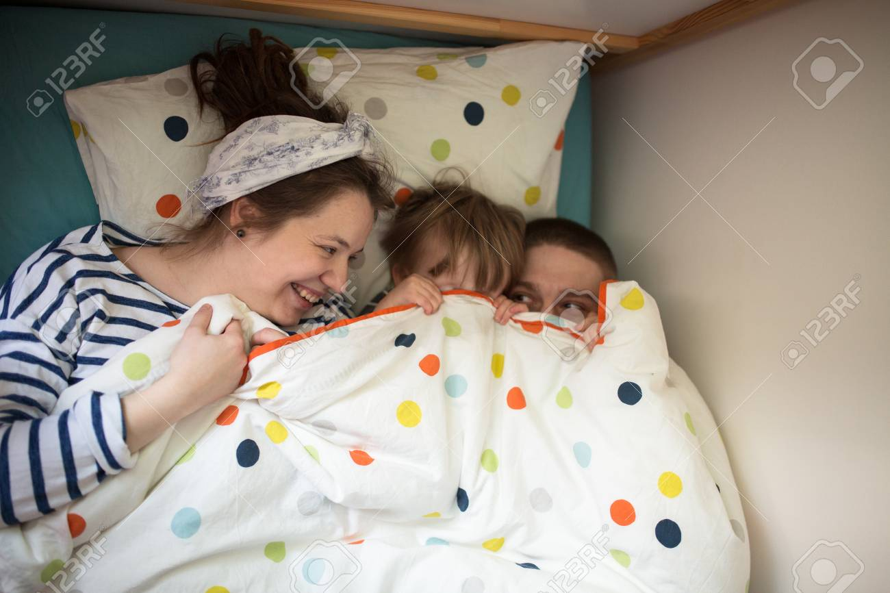 84079ad7403 Hugging A Fun Family With Son Playing In The Children s Bed