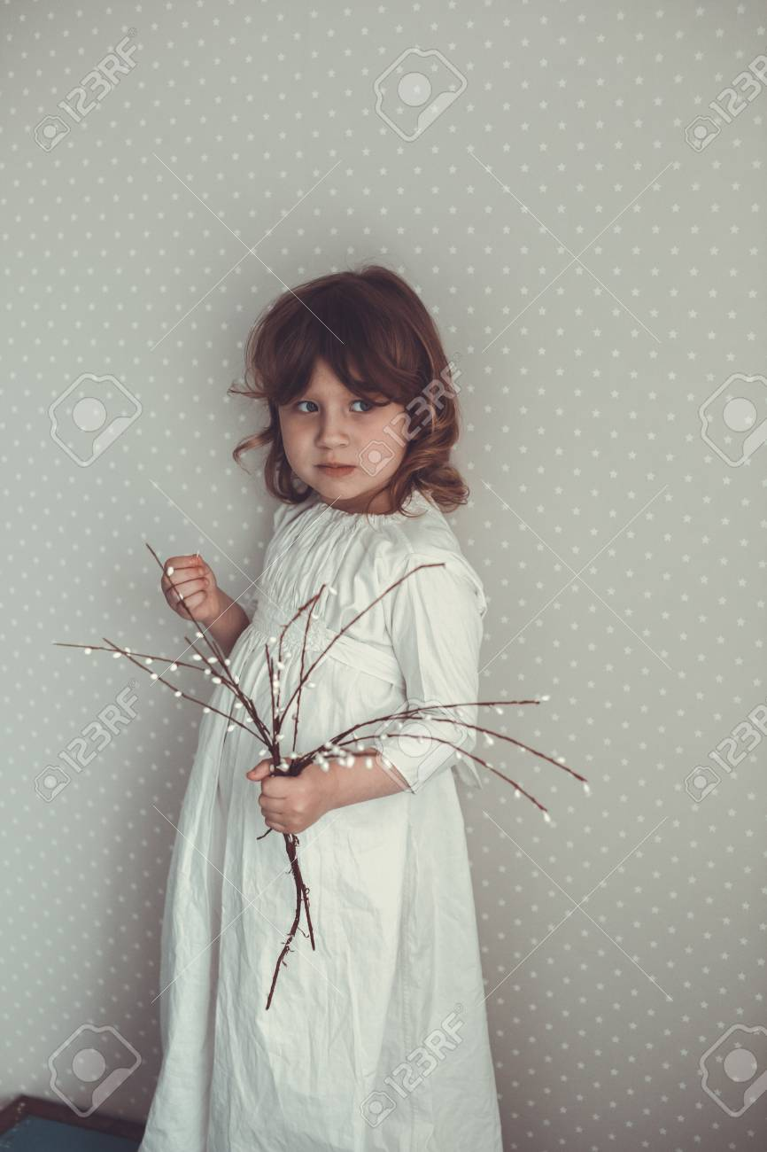 Stock Photo - tender girl in a nightgown retro with sprigs of willow 56ff9b753
