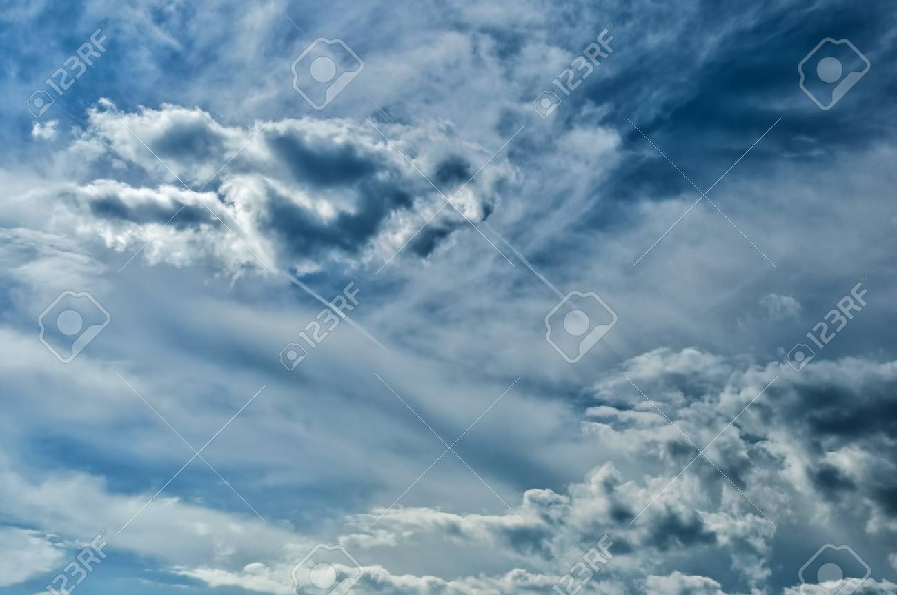 935f6f71dafc Stock Photo - the storm sky with various shades of blue color and white  clouds