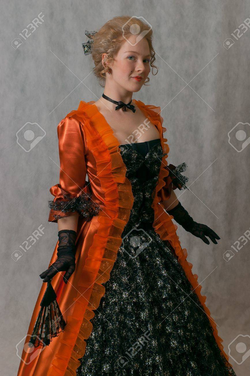 Studio Shot Of Standing Girl With Baroque Dress And Hairstyle Stock ...