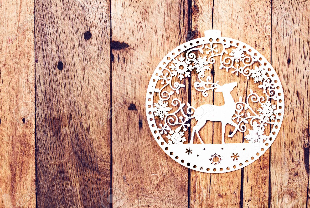 Christmas Card With White Christmas Ornaments On Rustic Wooden ...
