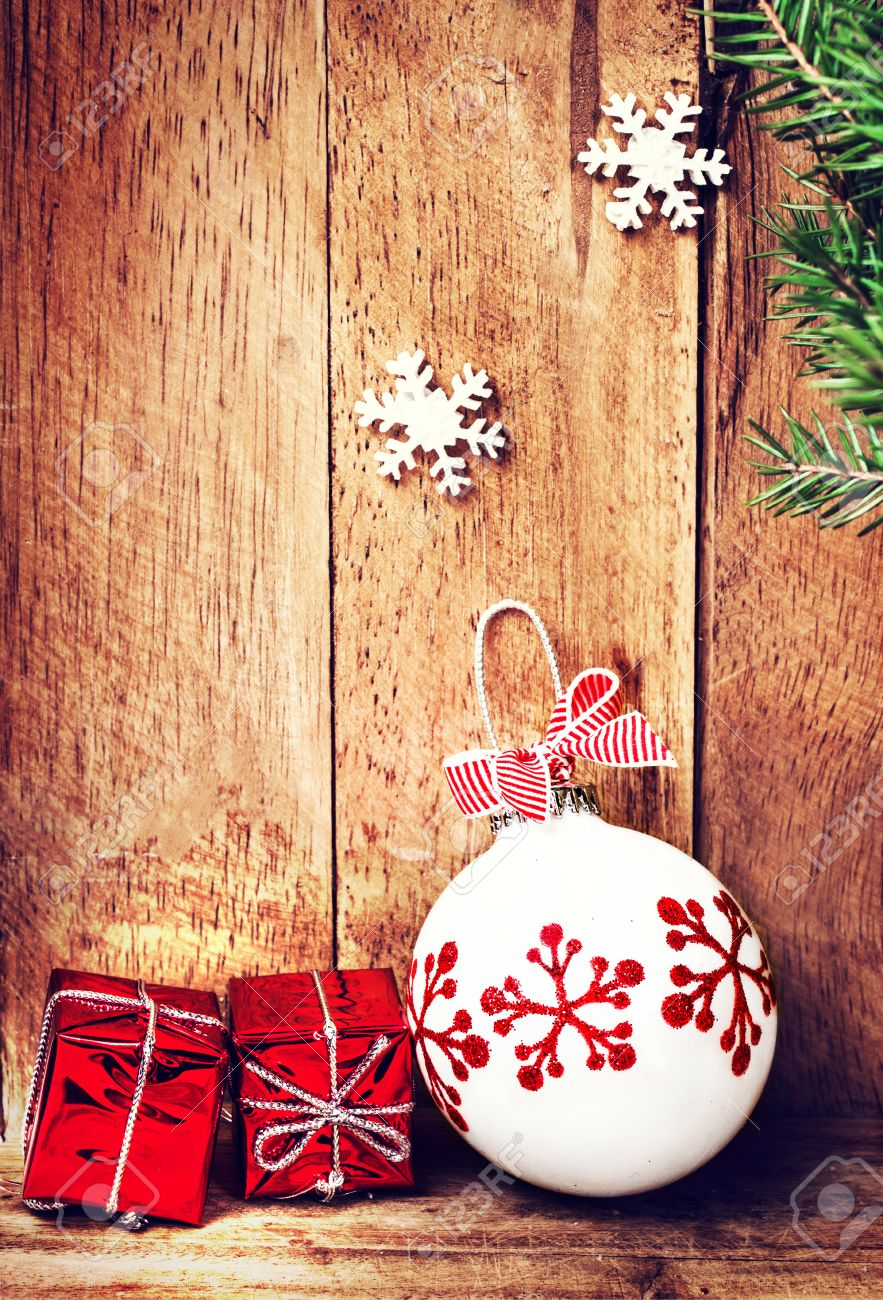 Old Fashioned Christmas Ornaments Over Wooden Background With