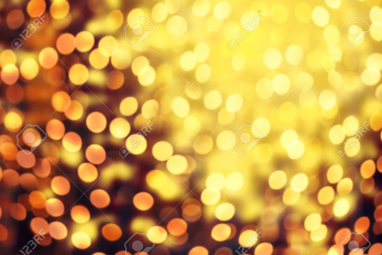 Abstract Christmas Glitter Vintage Lights Background. Dark Gold Glitter  Defocused Wallpaper With Sparkling Bokeh Stock