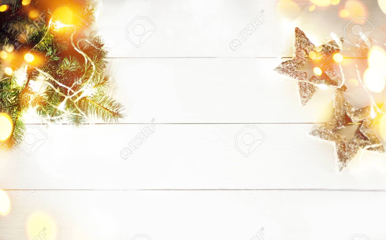 88474135 christmas decorations on white wooden background christmas frame made of fir branches with copy spac