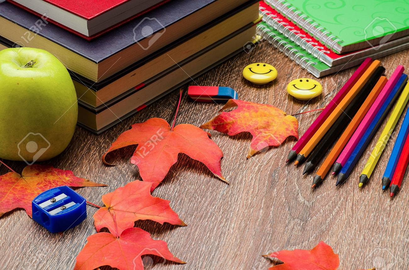 books notebooks pencils stationery green apple and autumn