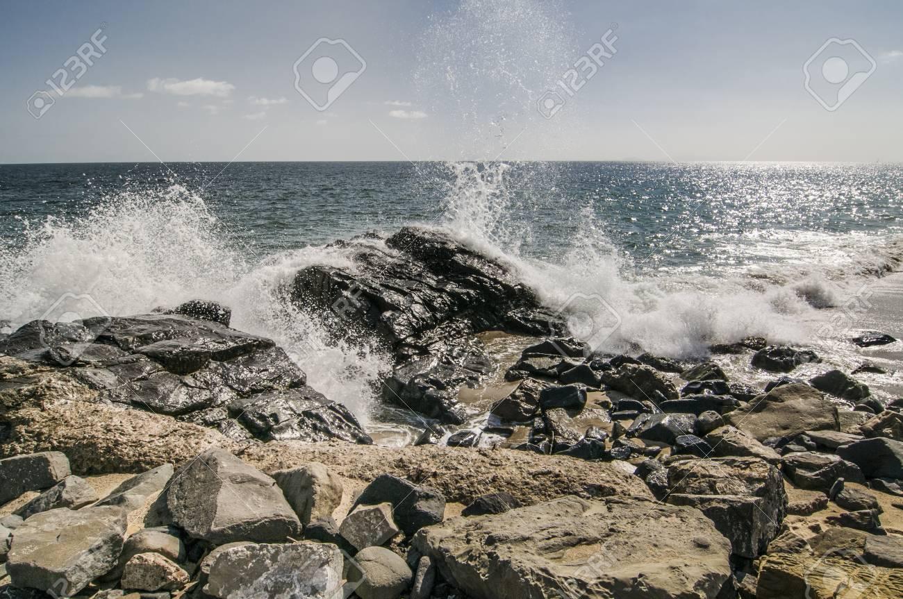 Waves crashing over rocks at Thornhill Broom beach in California