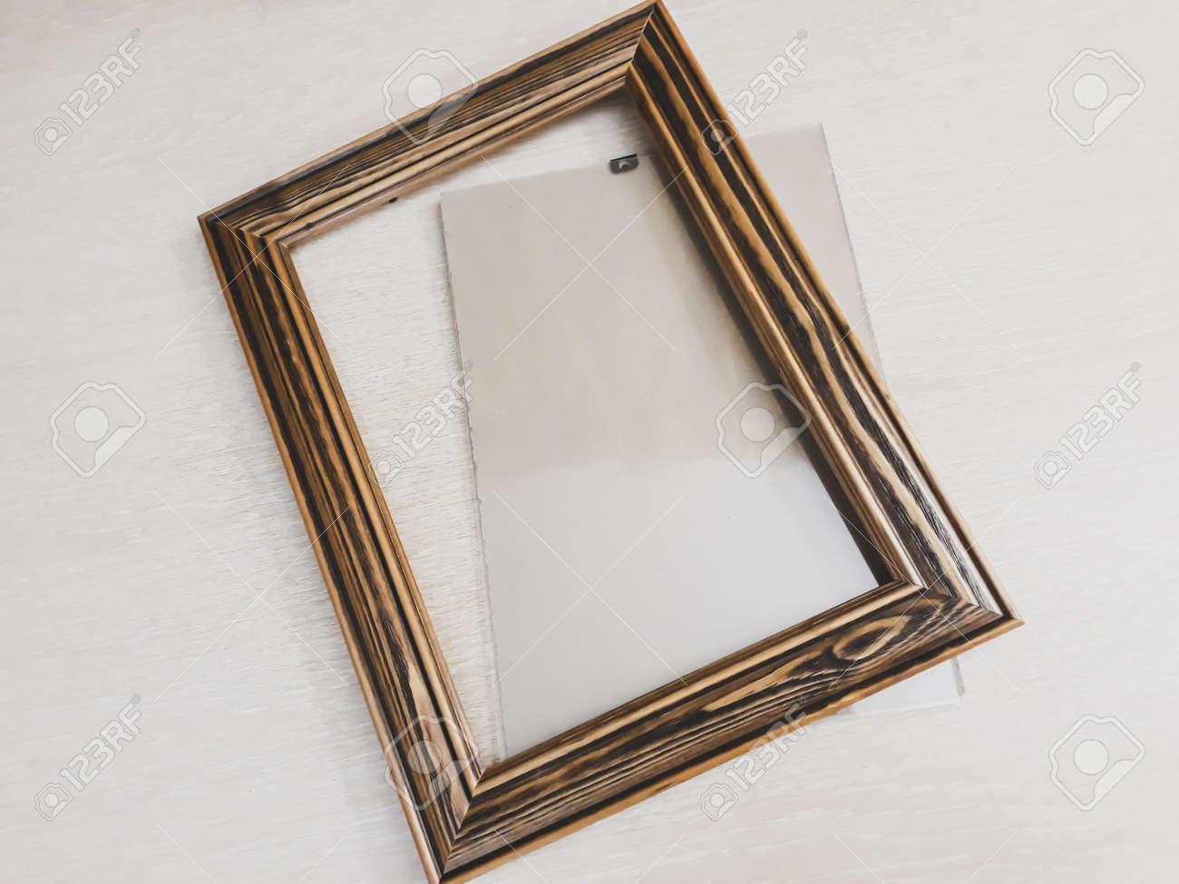 Frame of dark wood for needlework on a light background, horizontal photo - 159737689
