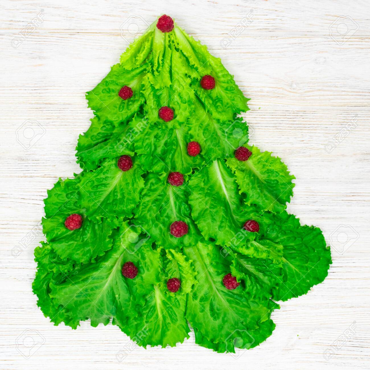The Christmas Tree Is Lined With Green Lettuce Leaves Decorated Stock Photo Picture And Royalty Free Image Image 157144432