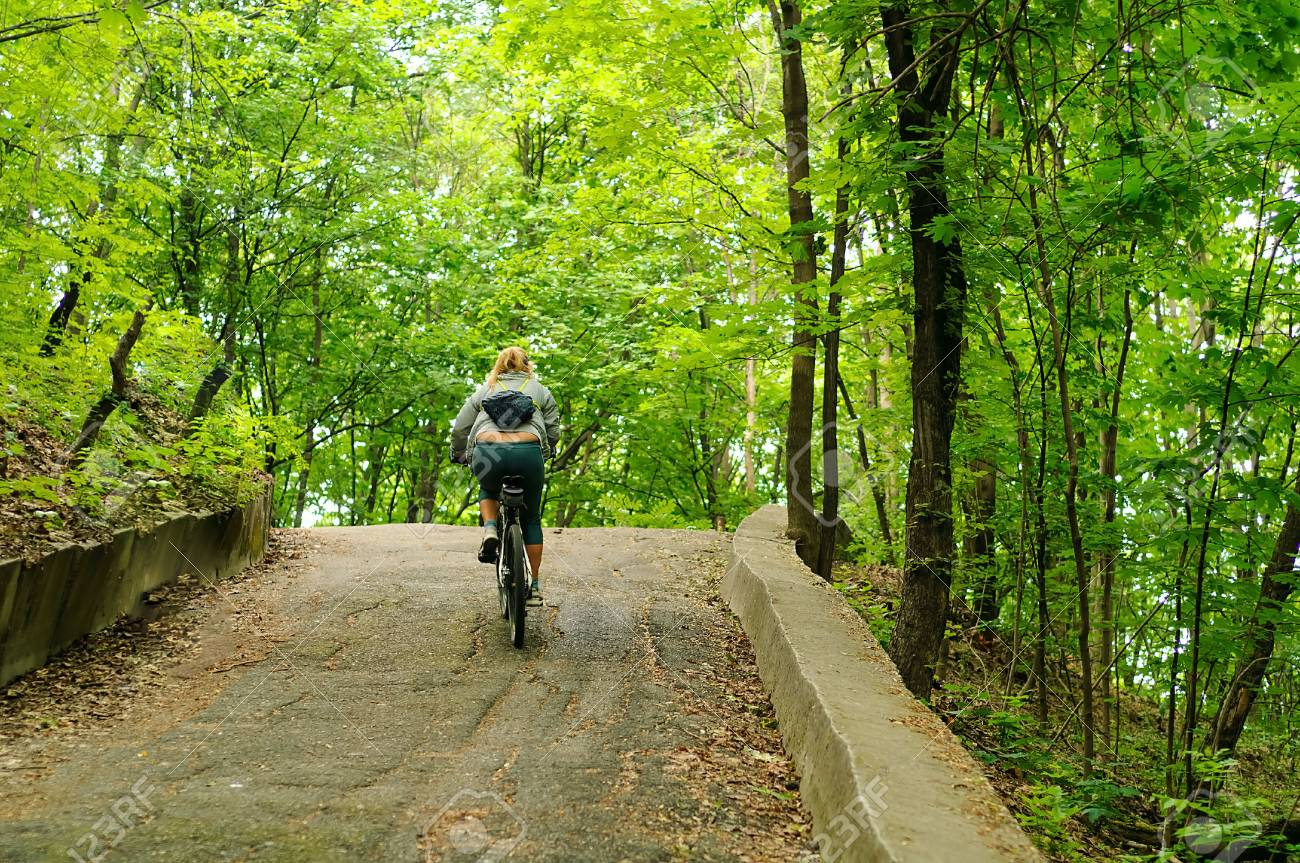 young girl on a bicycle on steep path sport concept biking in a