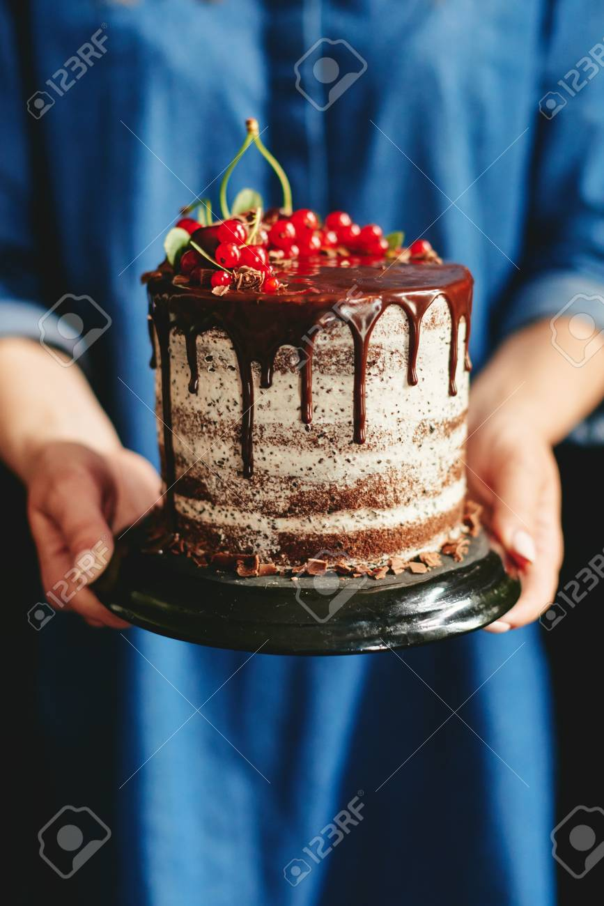 Girl Holding Tasty Beautiful Chocolate Cake With Red Berries Stock