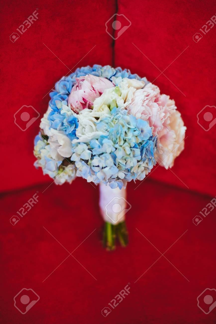Wedding Bouquet With Blue Hydrangea And Pink Peonies On Red Background Stock Photo Picture And Royalty Free Image Image 72525596