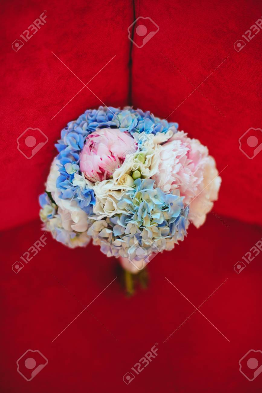Wedding Bouquet With Blue Hydrangea And Pink Peonies On Red