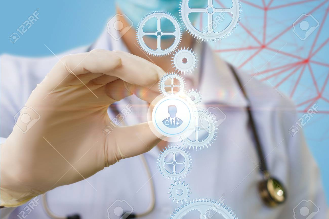 Doctor puts a icon of a doctor to the mechanism. The concept of choice of doctor for treatment. - 85348601