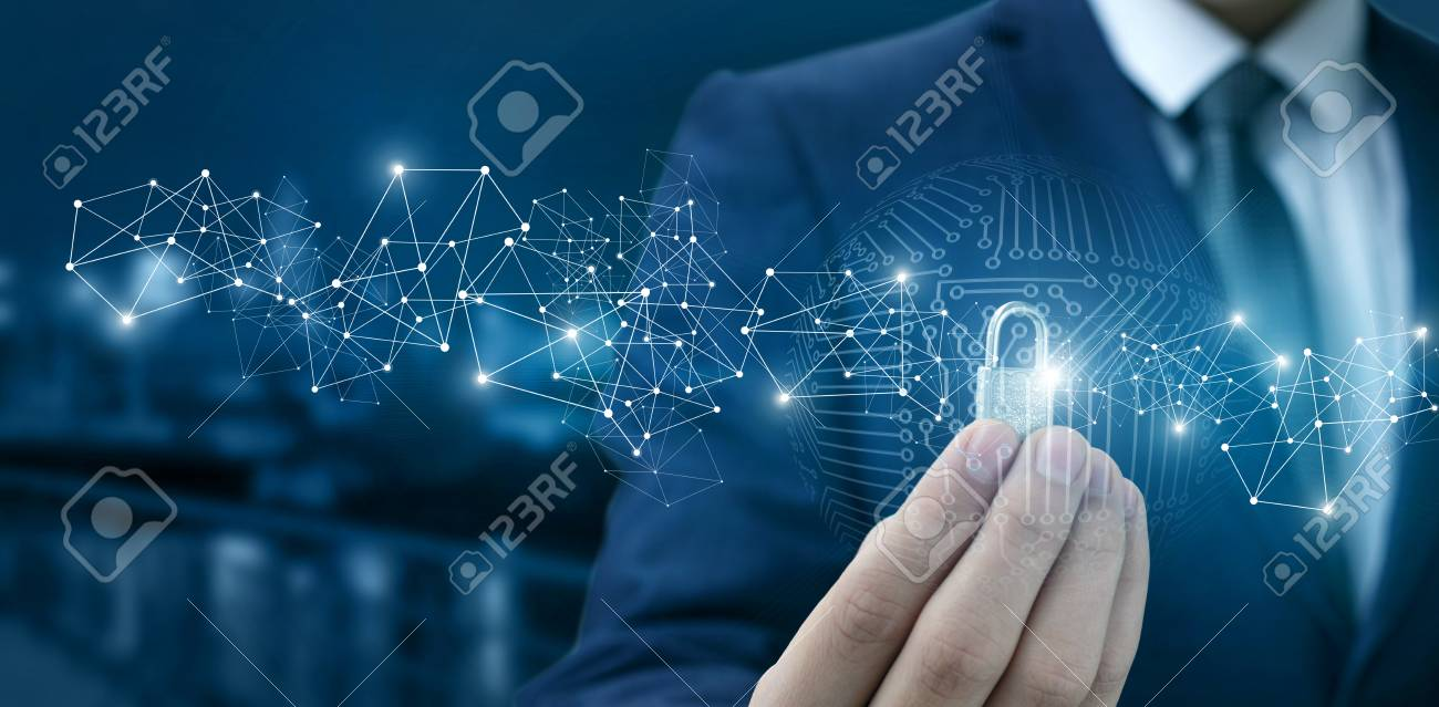 Lock for protection of the network in the hands of a businessman on a blurred background. - 94514401
