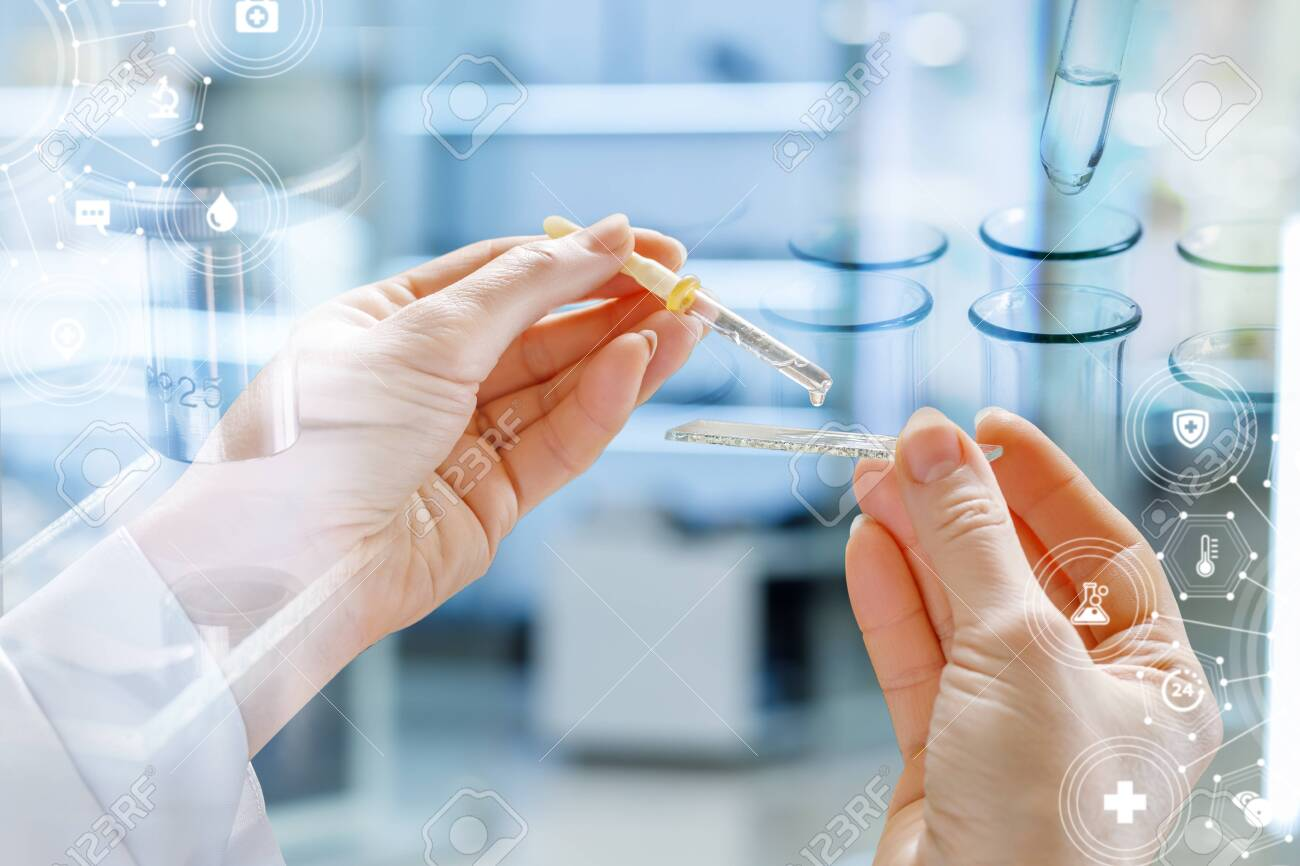 The concept of services of the laboratory tests. Hand with medical sample and pipette on blurred background. - 135132438