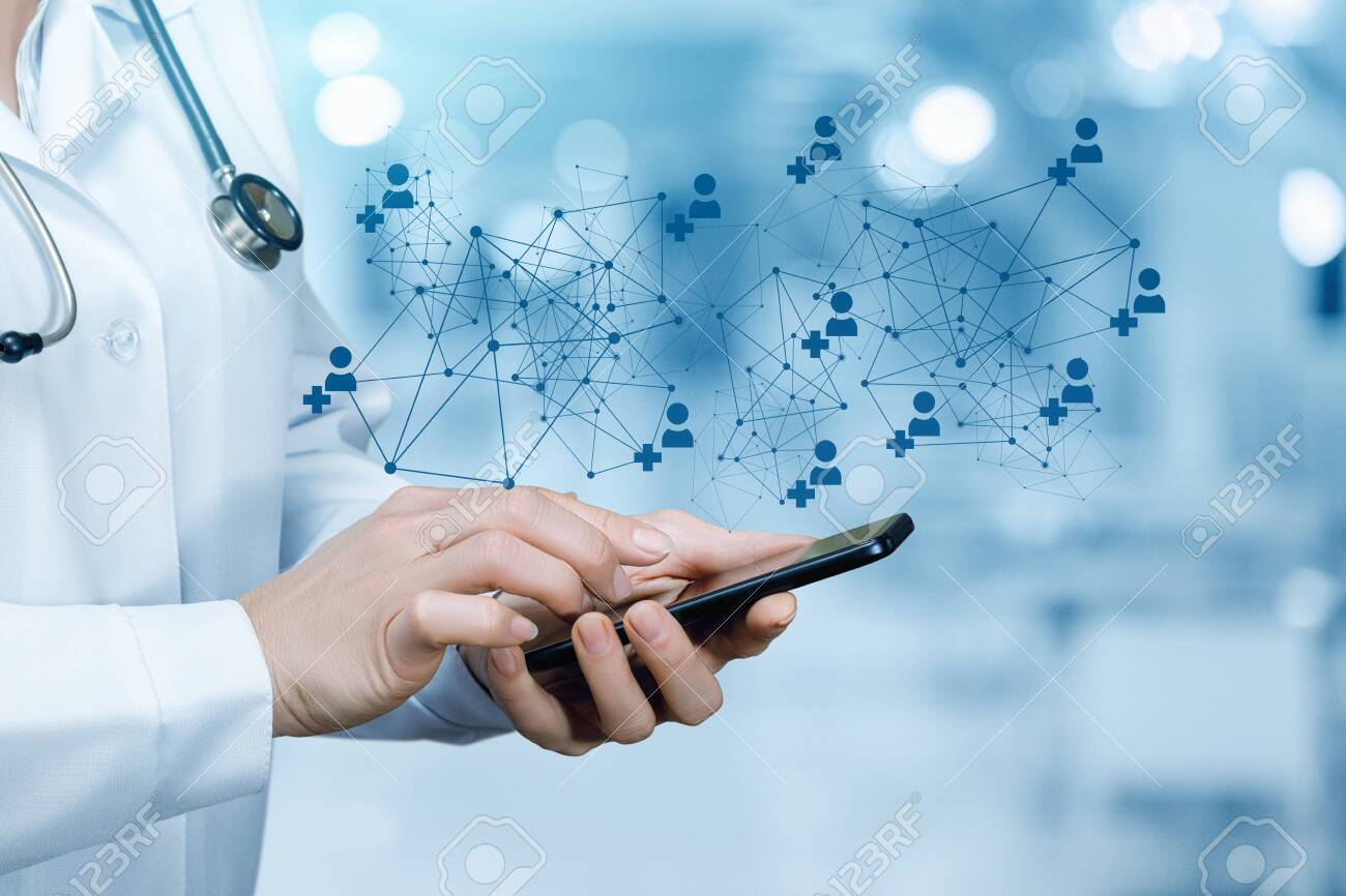 The doctor working at the medical network on the mobile device. - 137725071