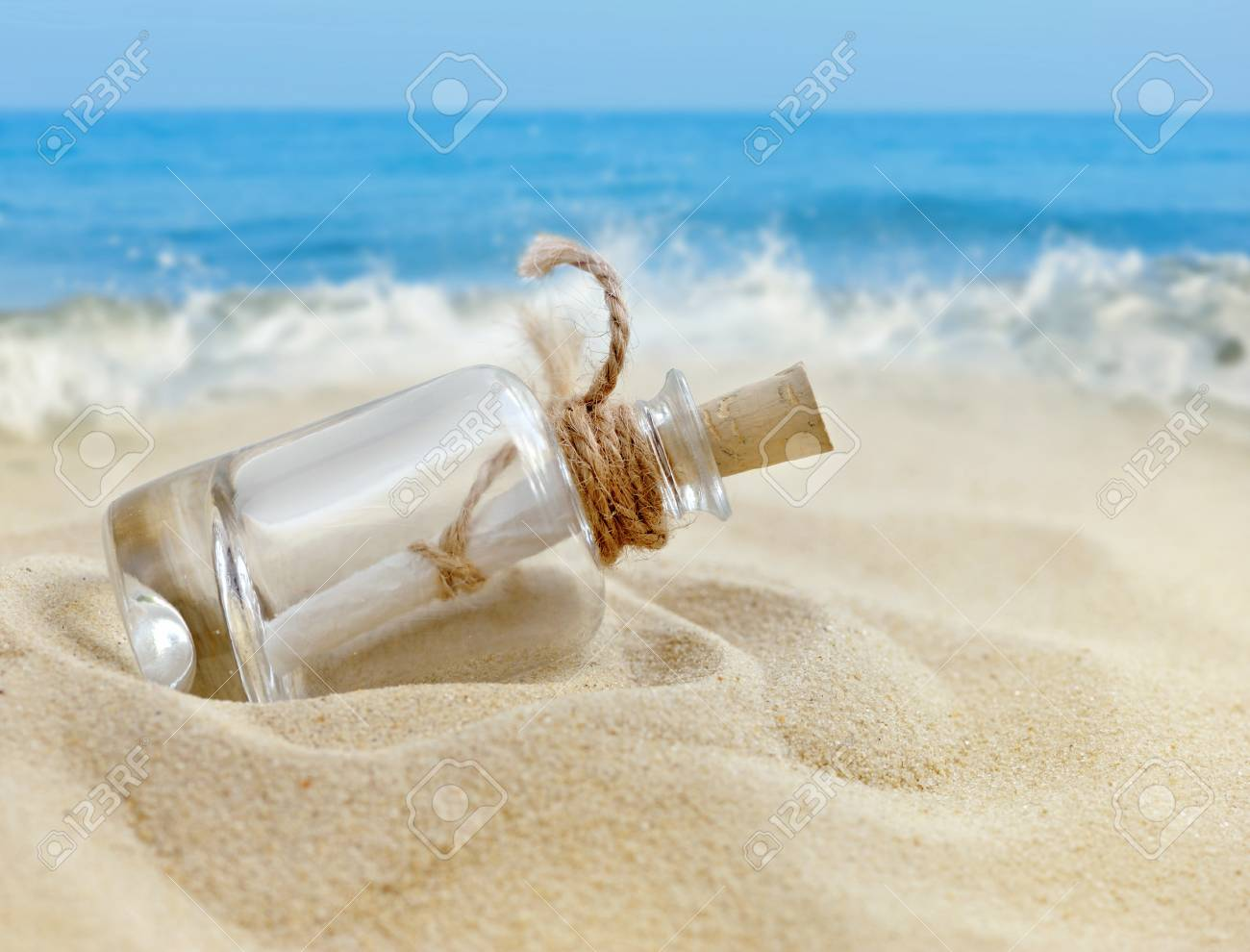 a letter in a bottle on the beach stock photo 51600188