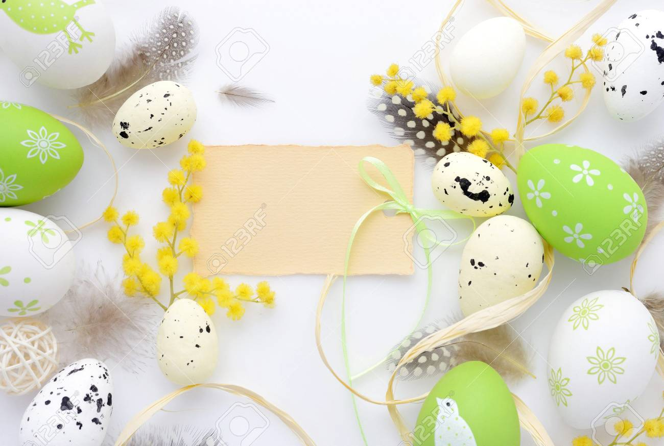 Easter eggs and mimosa flowers on white background with blank easter eggs and mimosa flowers on white background with blank card to greet top view m4hsunfo