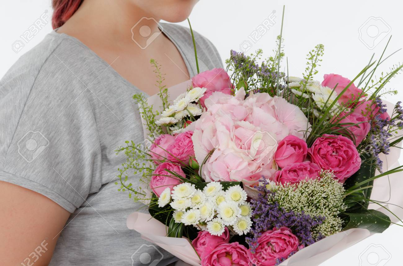A Girl In Casual Clothing Is Holding A Bouquet Of Flowers. No ...