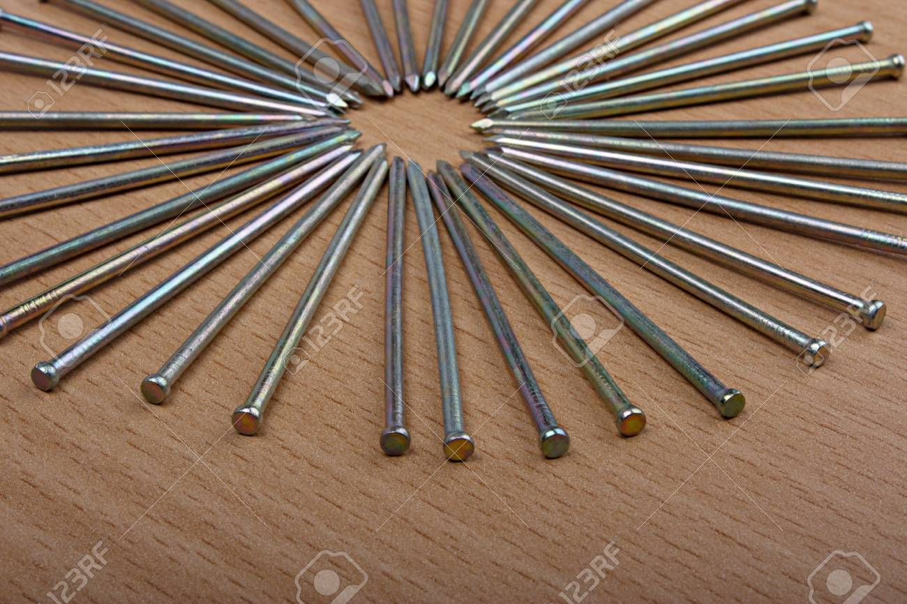 Nails on wooden background, close up Stock Photo - 14523837