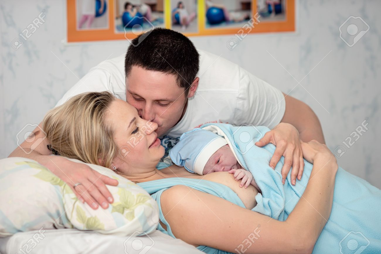 Young beautiful woman with a newborn baby after birth - 36895853