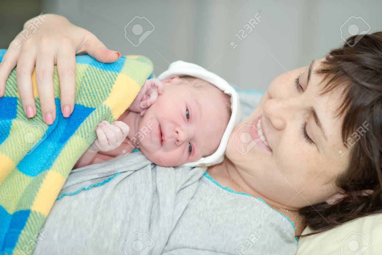happy woman after the birth of a newborn baby on a functional bed - 37155608